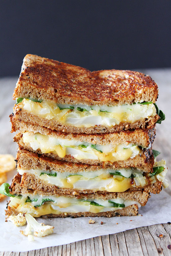 Cheese-roasted cauliflower, onions, arugula, lemon mustard aioli, Havarti, and Gouda cheese. Out of this world good!