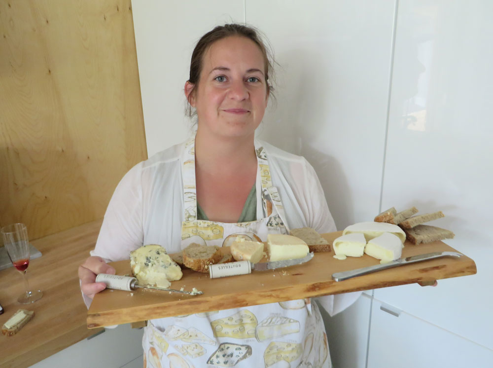 Cheesemaker Heather Robertson and three of the first cheeses made at Lighthall Vineyards and Dairy.