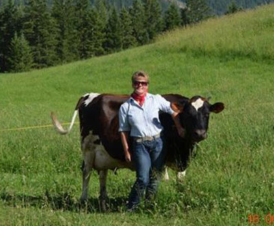 Mira Schenkel with Brittney, one of her four dairy cows on the farm in Salmon Arm, B.C.